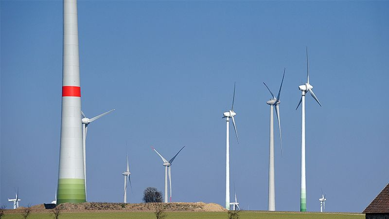 picture of a windpark with blue sky
