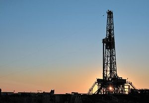 drill tower at sunset